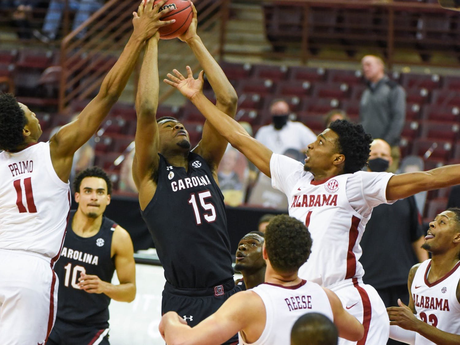 Sophomore forward/center Wildens Leveque holds the ball while Alabama players attempt to steal. South Carolina lost 81-78.