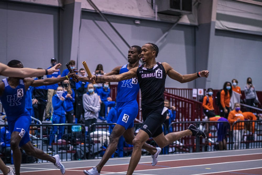 <p>&nbsp;Sophomore EJ Richardson passes the baton to his teammate during a relay race.&nbsp;</p>