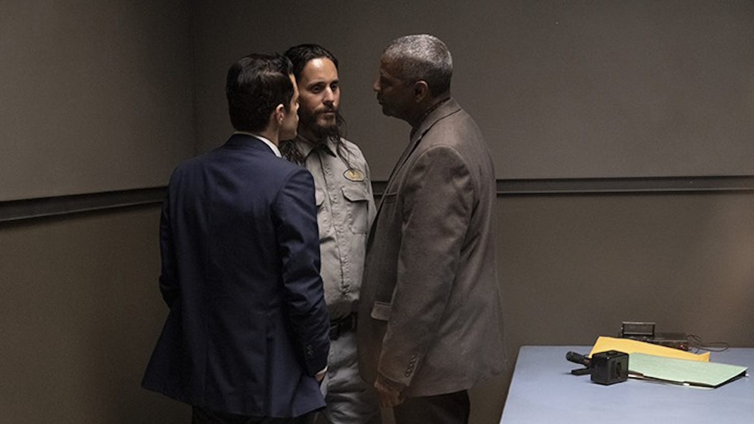 """Rami Malek, left, Jared Leto, center, and Denzel Washington talk in a scene from """"The Little Things""""."""