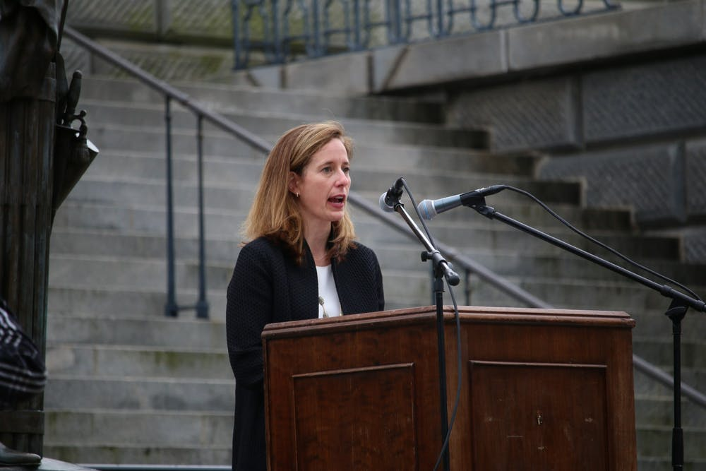 """<p>Ann Warner, CEO of Women's Rights and Empowerment Network (WREN), speaks during Tuesday's protest. WREN was one of the organizations that put together the drive-by """"Stop the Ban"""" protest.&nbsp;</p>"""