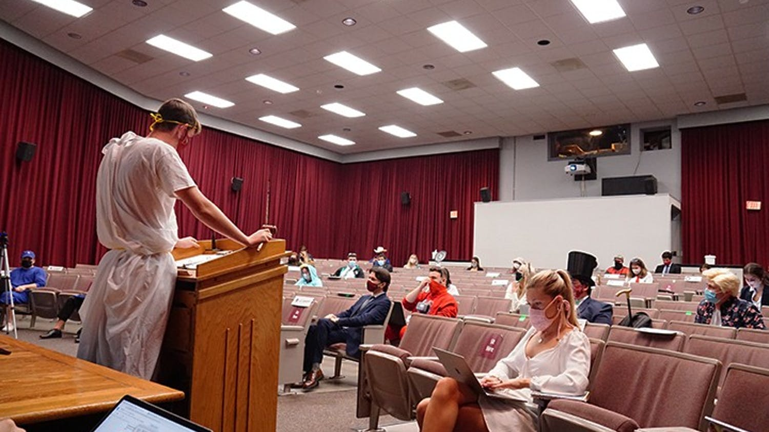 Speaker of the student senate JD Jacobus faces the senate in a toga. Students were encouraged to wear Halloween costumes to the meeting.