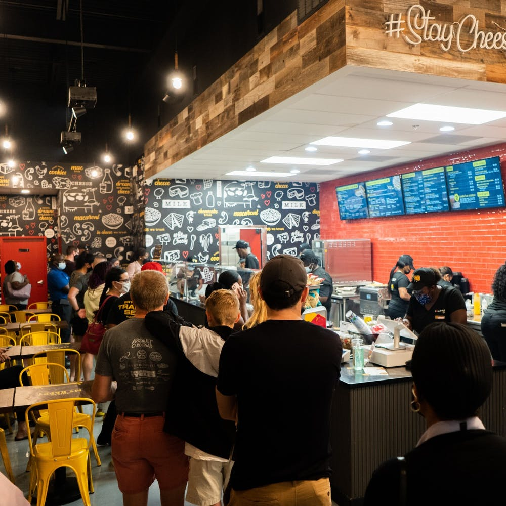 Customers wait in a line at the newly opened Restaurant I Heart Mac & Cheese.