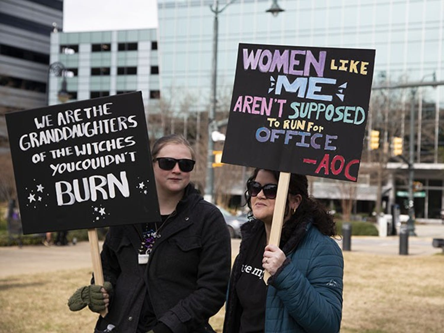 Emily Gunning, National lines on Mental Illness and Rachel Oxley, Receptionist Emily Gunning (right) and Rachel Oxley (left), holding their signs during the march, were there to show their opinions on women's rights.
