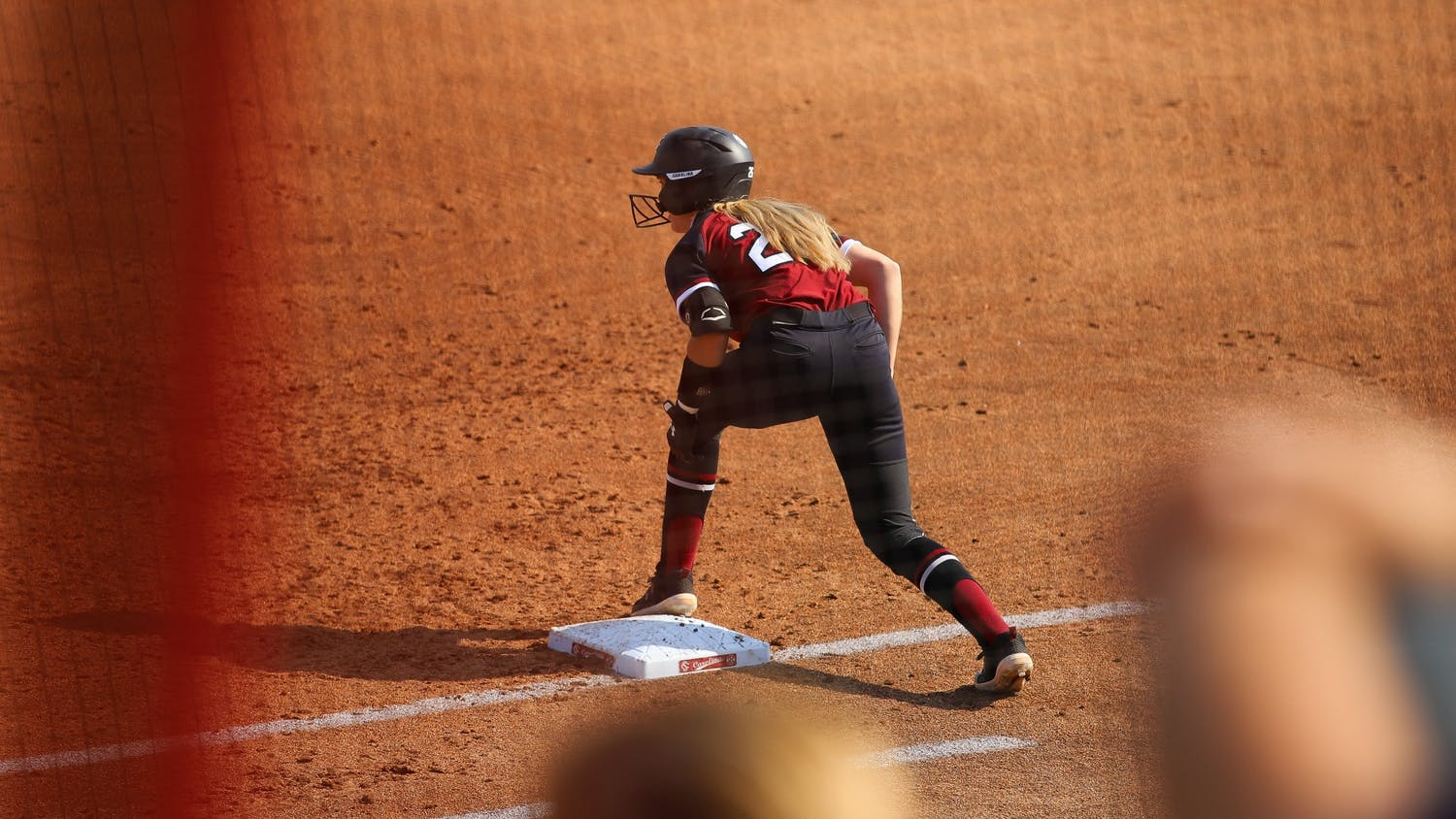 Freshman infielder Riley Blampied stands at first base while preparing to run towards second base.