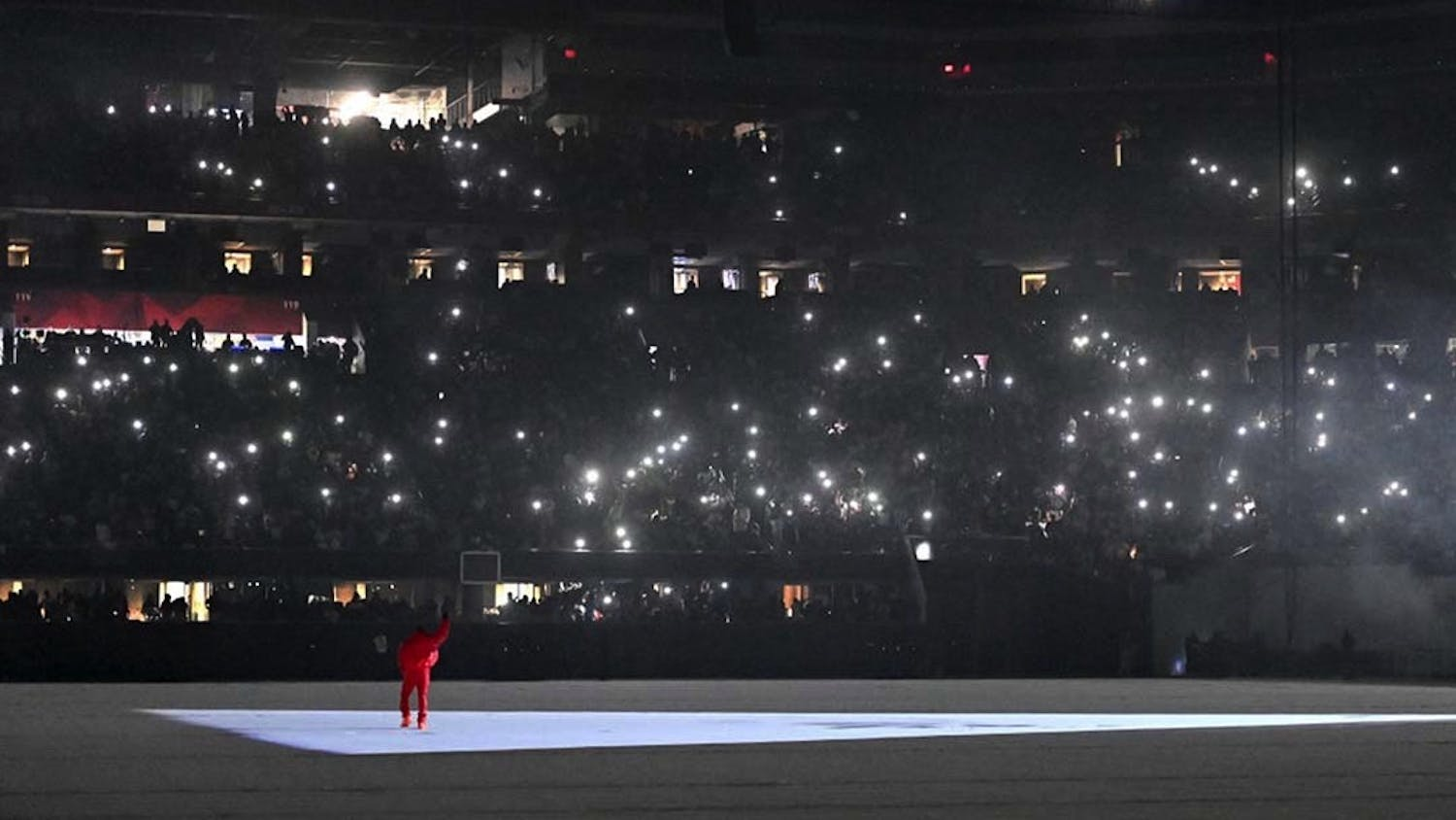 """Kanye West performs his songs at the """"DONDA by Kanye West"""" listening event at the first Donda listening party, in the Mercedes-Benz Stadium. West's most recent album was released through labels GOOD Music and Def Jam Recordings and is named after his mother."""