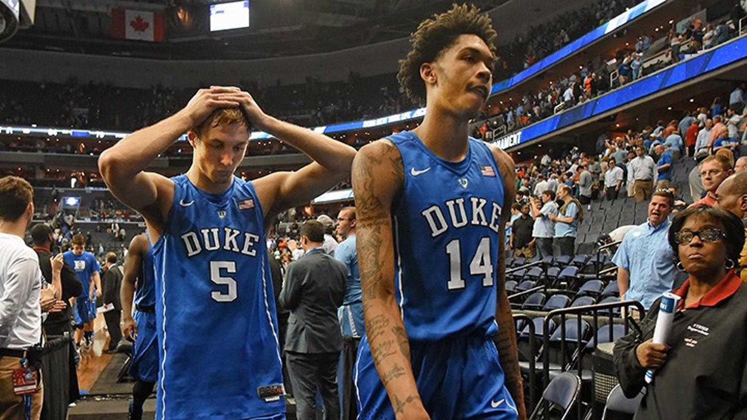 Duke guard Luke Kennard (5) and guard Brandon Ingram (14) leave the floor after losing in overtime to Notre Dame 84-79 at the ACC Tournament at the Verizon Center on March 10, 2016 in Washington, D.C. (Chuck Liddy/Raleigh News & Observer/TNS)