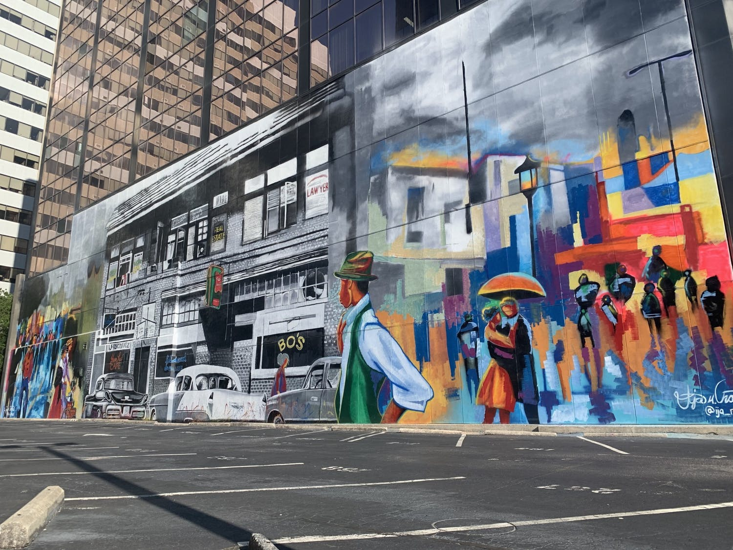 A mural depicting Black Wall Street on the side of the City of Columbia building. The artist, Ija Charles, is a 24-year-old self-starter from Columbia and Louisiana.