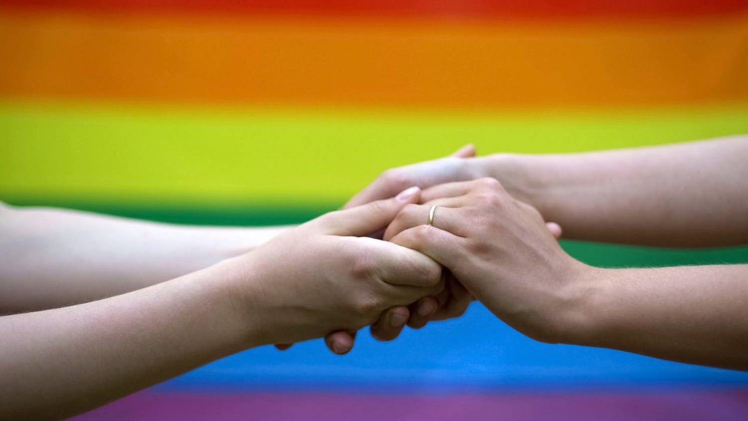 Gay wedding, rainbow flag on background, same-sex marriage, minority rights