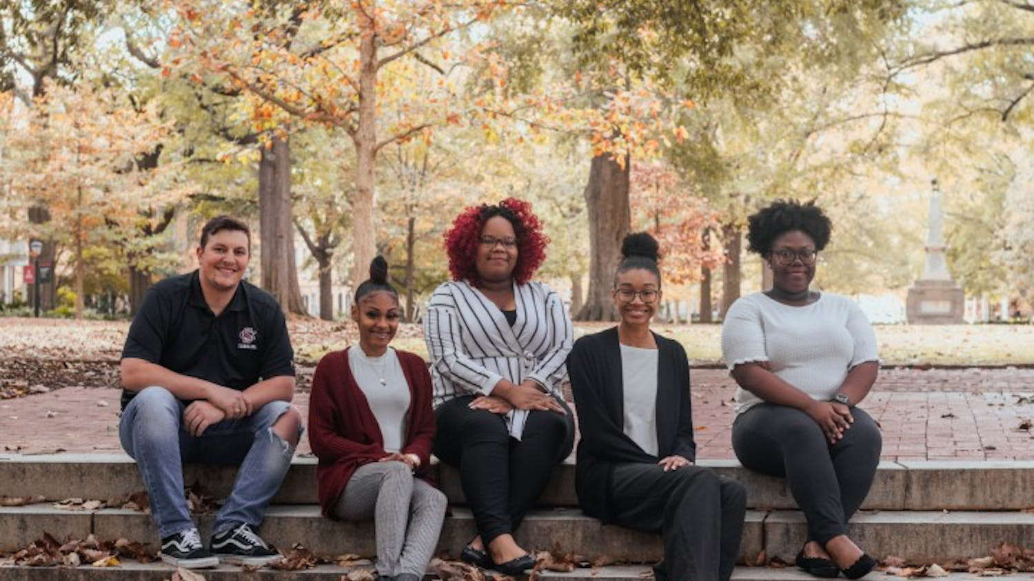 From left to right: Bradley Barker, A'ya Hall, Alyssia Ross, Yaunna Hunter and Kailah Green pose for a photo at the Horseshoe. The group makes up a portion of the Association of Transfer Students, an organization that provides support and community for transfer students of all ages.