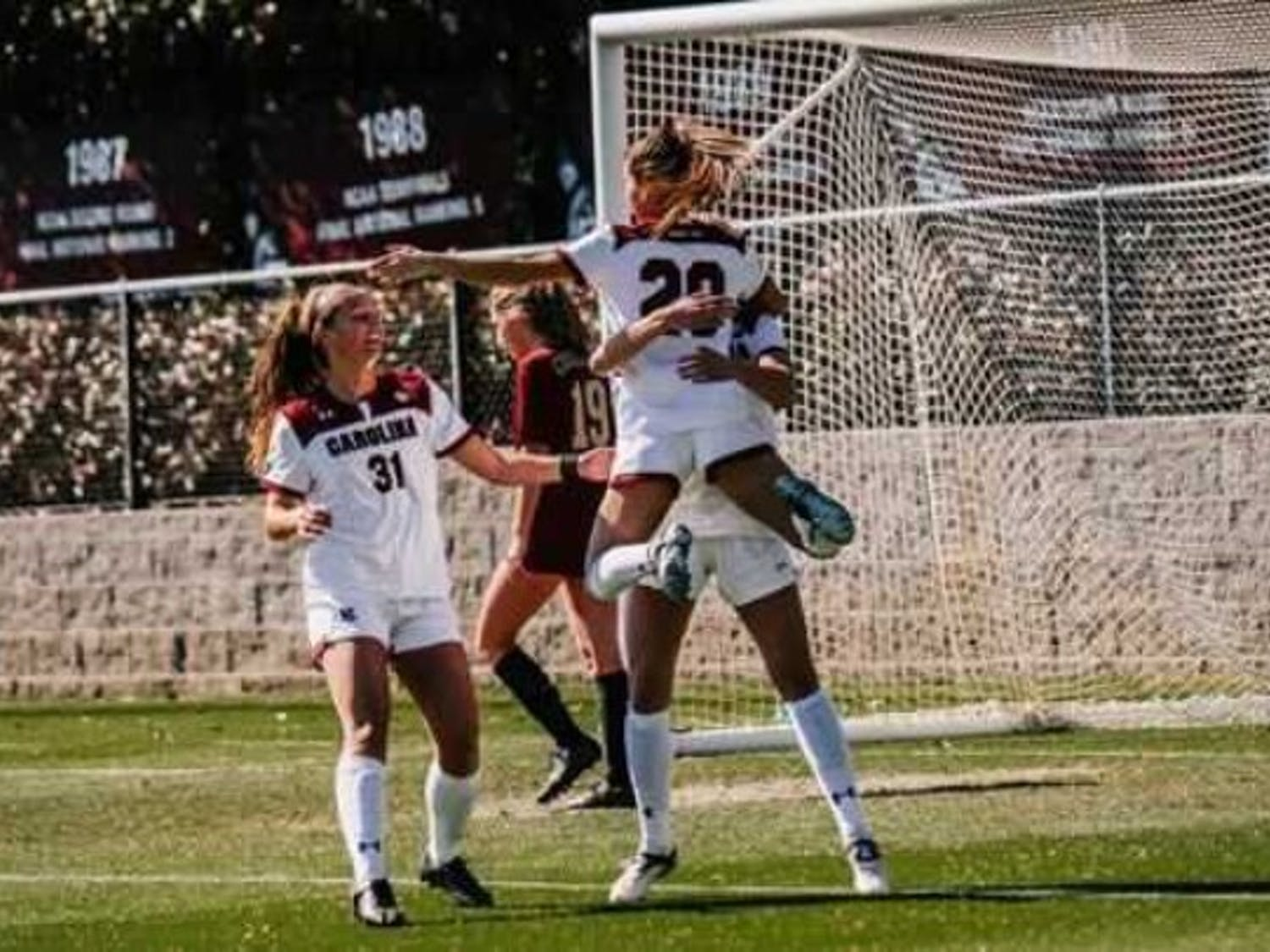 Members of the South Carolina women's soccer team celebrate a goal in their Sunday win over College of Charleston.
