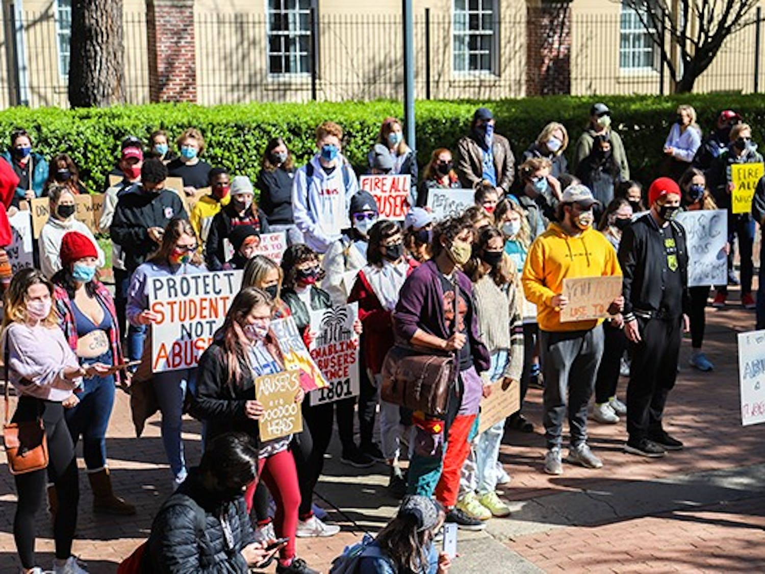 A shot of the crowd as they hold a variety of signs while at their second stop during the march, Gambrell Hall.
