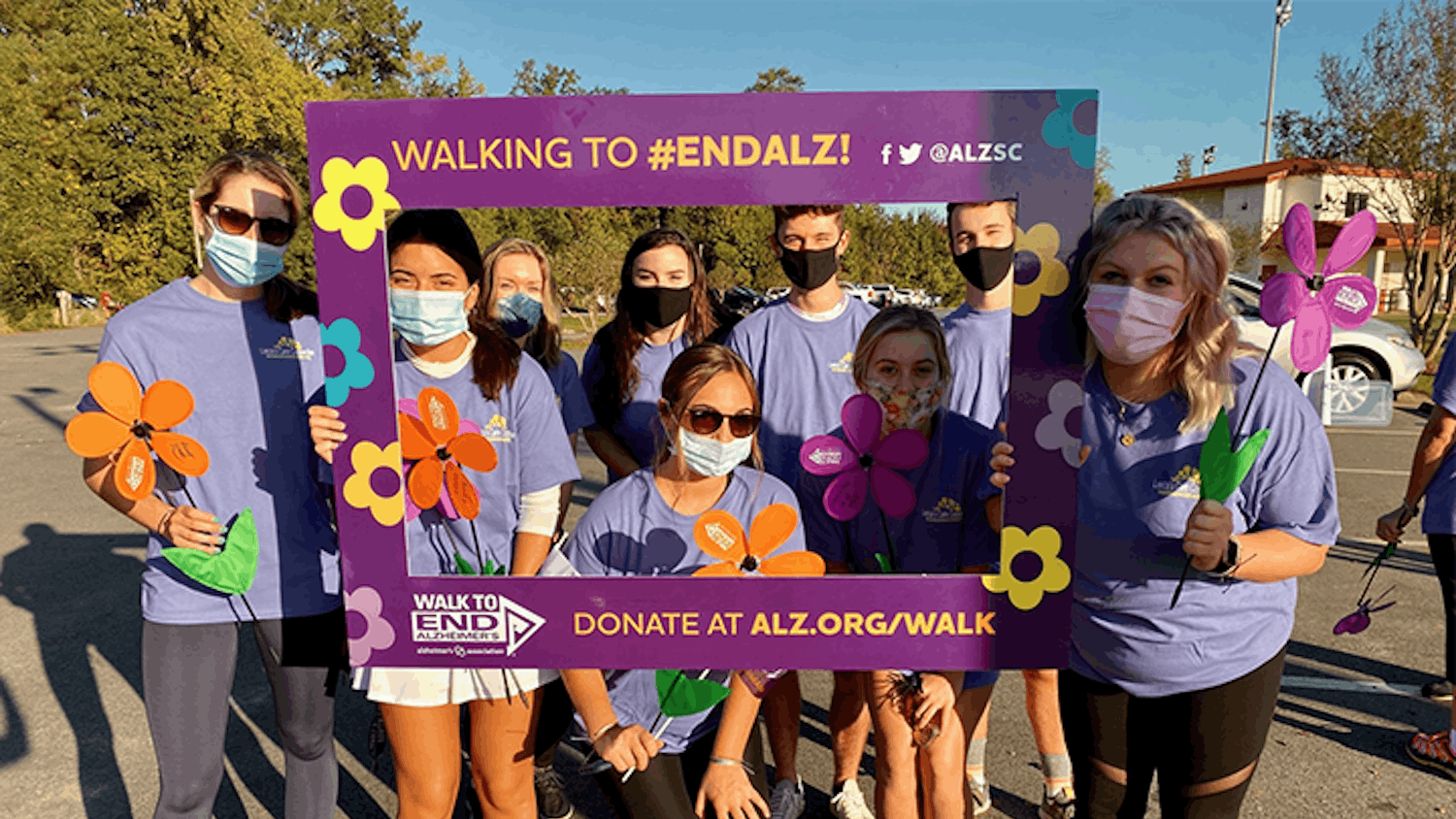 "The Advocates Against Alzheimer's group poses with a frame prop during the Alzheimer's Association's ""Walk to End Alzheimer's"" event on Saturday, Oct. 12."