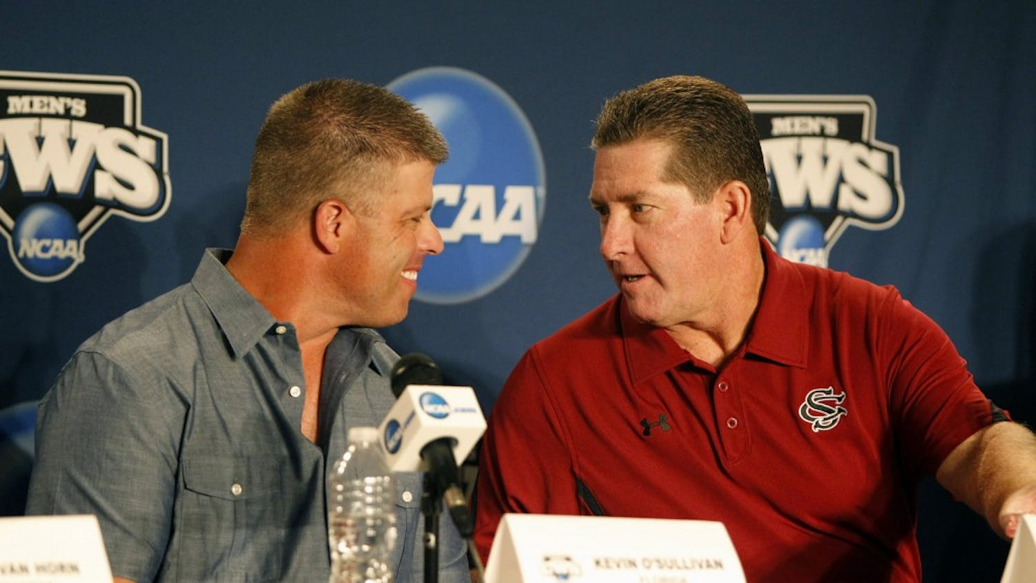 Florida head coach Kevin O'Sullivan, left, and South Carolina head coach Ray Tanner chat prior to a press conference in preparation for the College World Series at TD Ameritrade Park in Omaha, Nebraska, Thursday, June 14, 2012. (Gerry Melendez/The State/MCT)