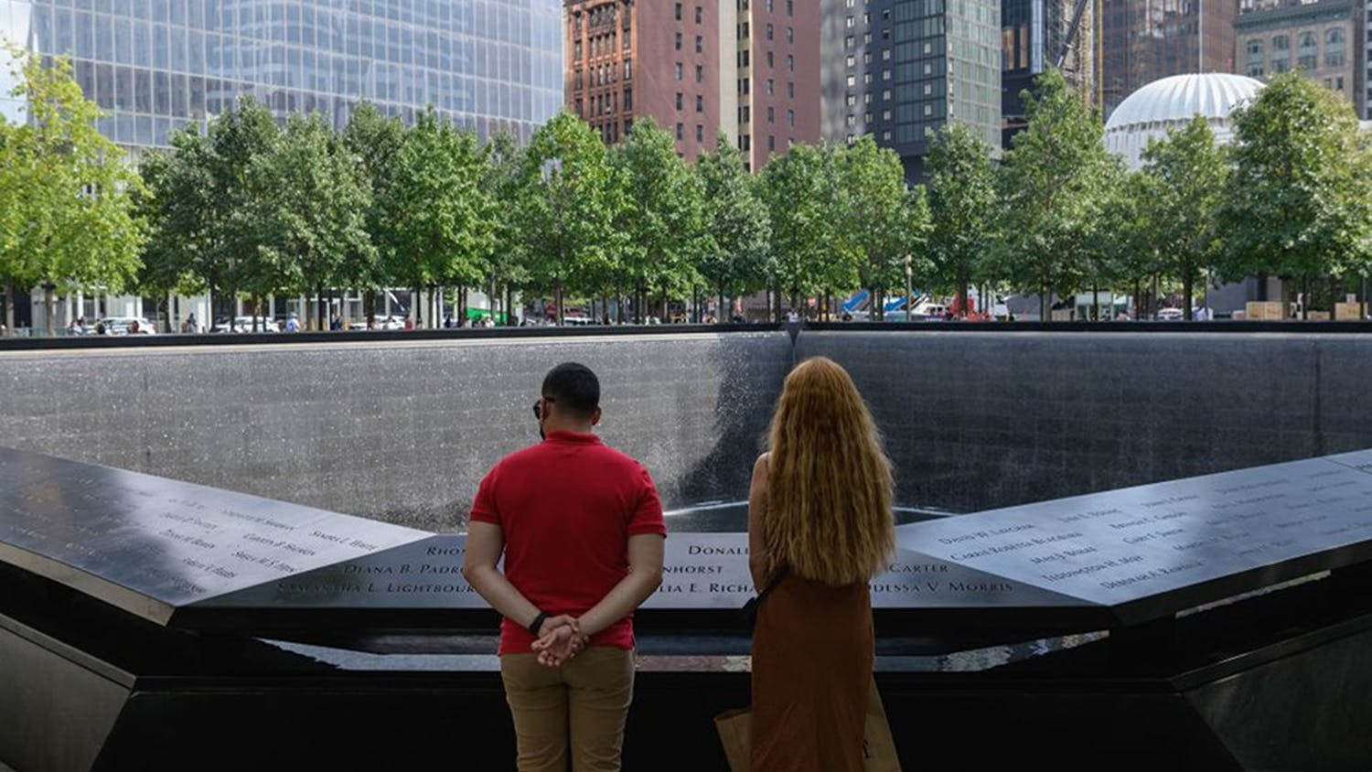 A couple stands before the National September 11 Memorial, marking the site of the south tower at the World Trade Center in New York, on September 8, 2021. (Angela Weiss/AFP via Getty Images/TNS)