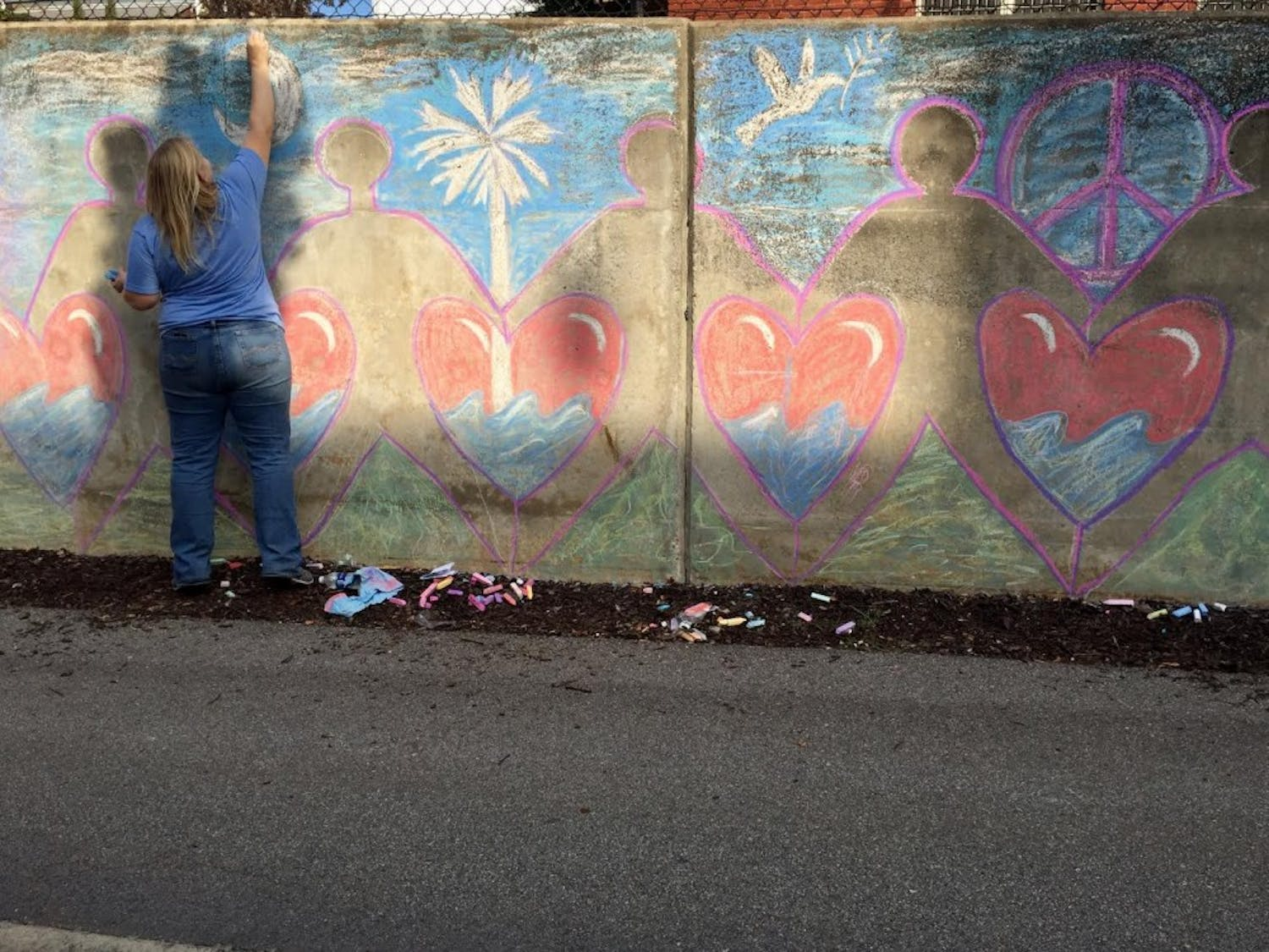An artist spreads love and hope through her artwork on the walls of the Lincoln Street tunnel.