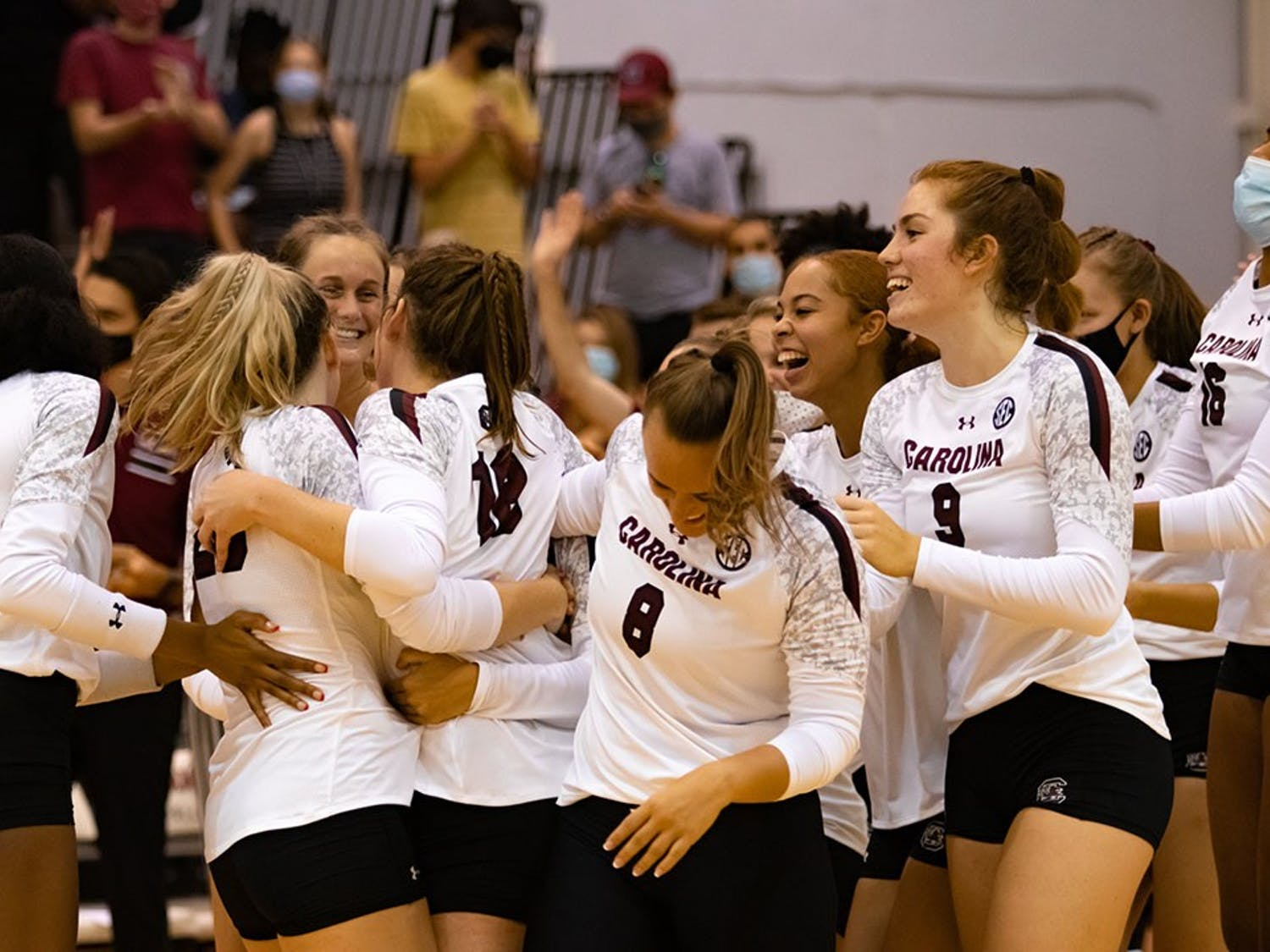 The Gamecock Volleyball team celebrates Freshman Emmy Rollins first collegiate career kill. Rollins earned the game winning point completing a three-set sweep over the High Point Panthers.