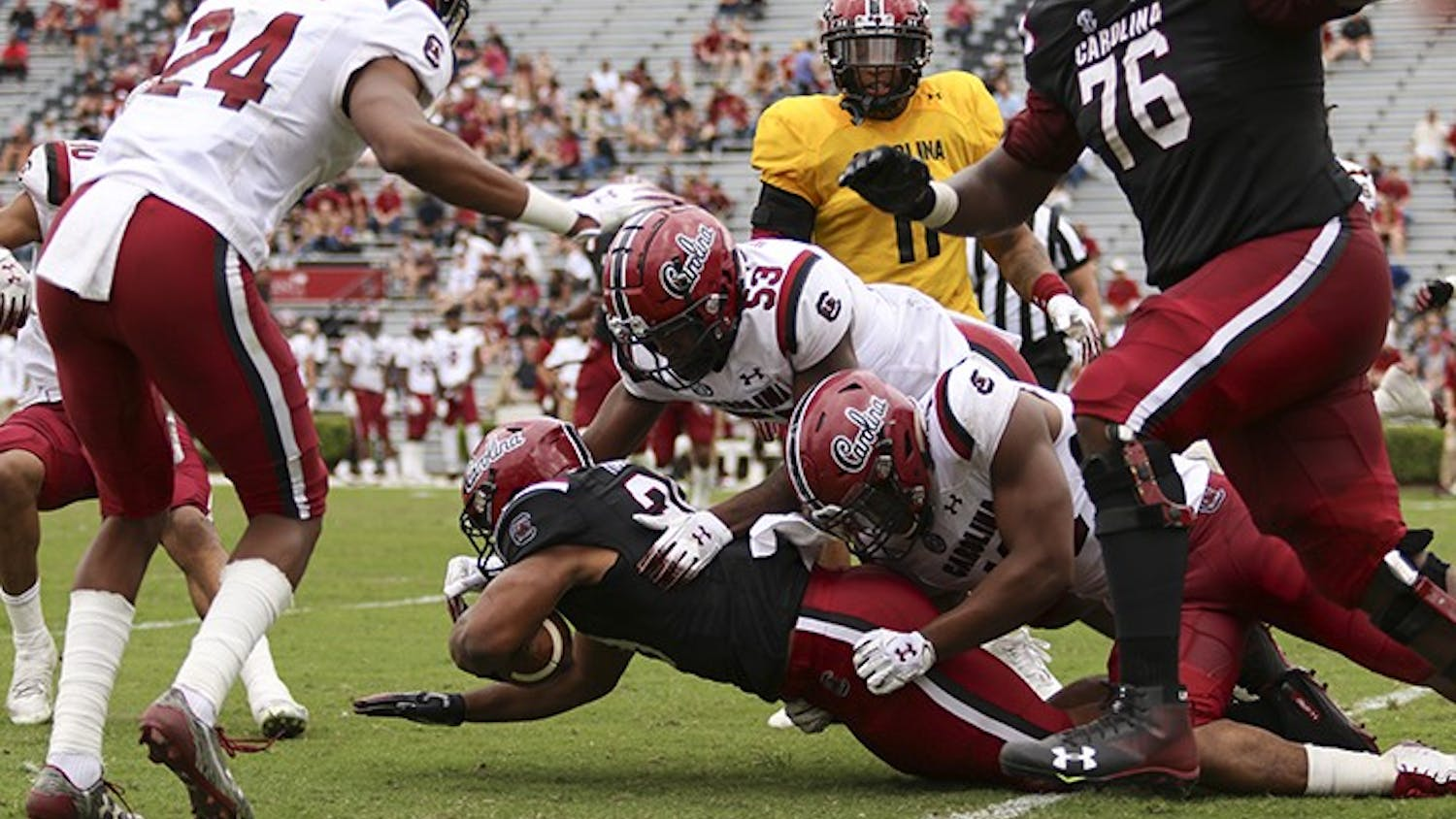 Gamecock players make a tackle during the spring game at Williams-Brice Stadium during the 2019 spring game.
