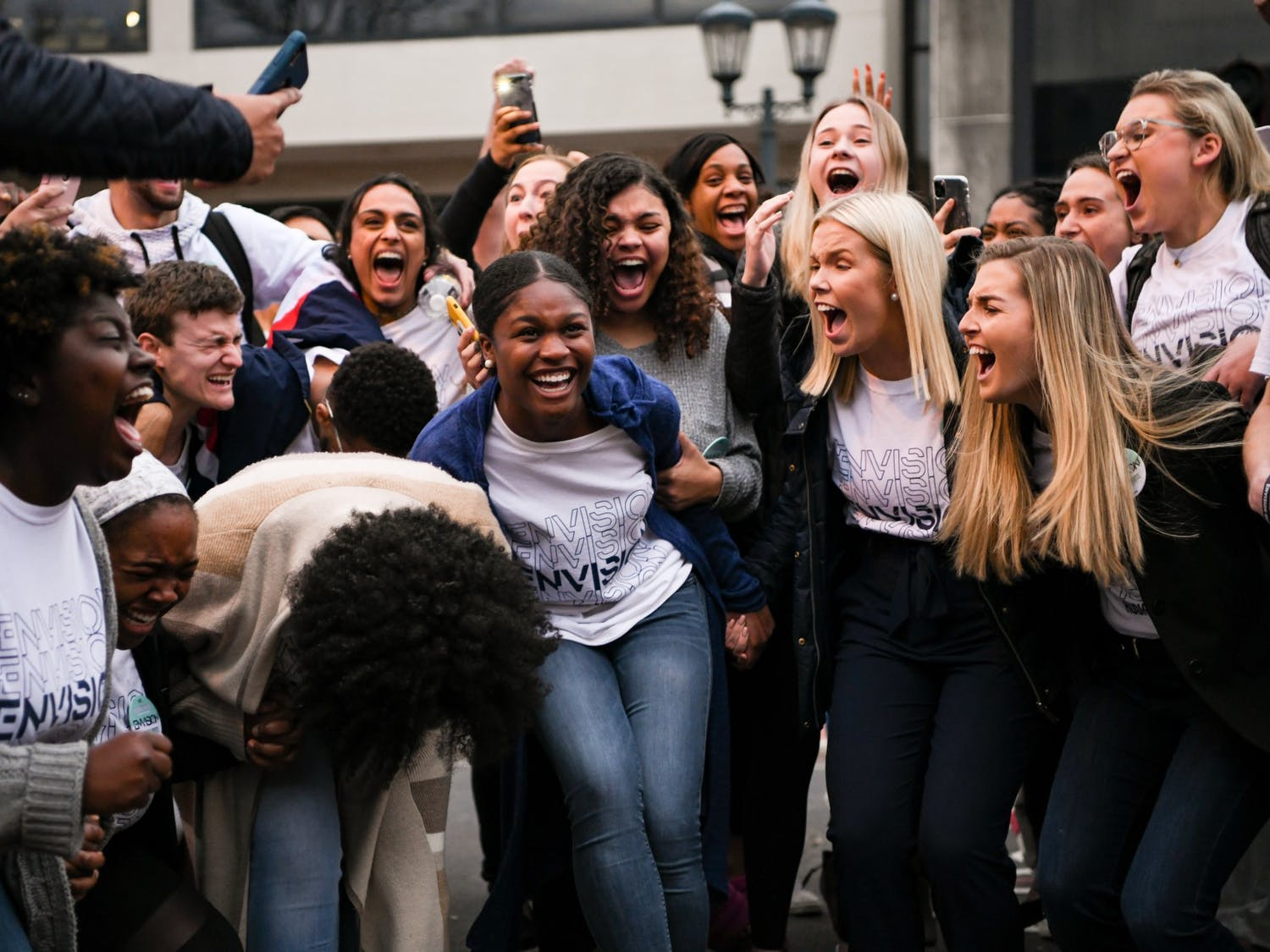 Newly elected Student Body Vice President Hannah White and Student Body President Issy Rushton celebrate their win surrounded by campaign supporters.