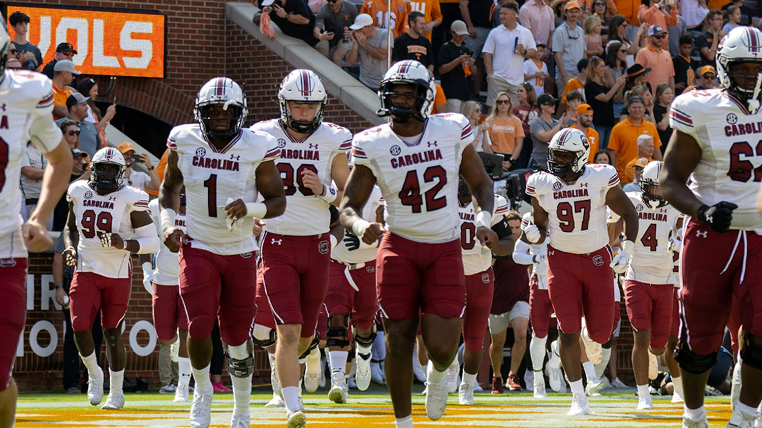 The Gamecocks run out onto the field of Neyland Stadium before facing off the Volunteers on Oct. 9, 2021.