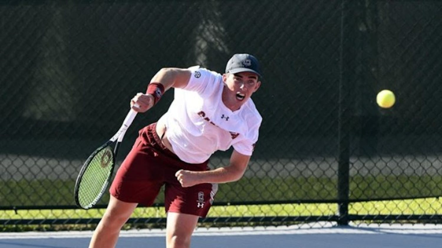 Freshman Connor Thomson serves in South Carolina's loss to #3 Tennessee.