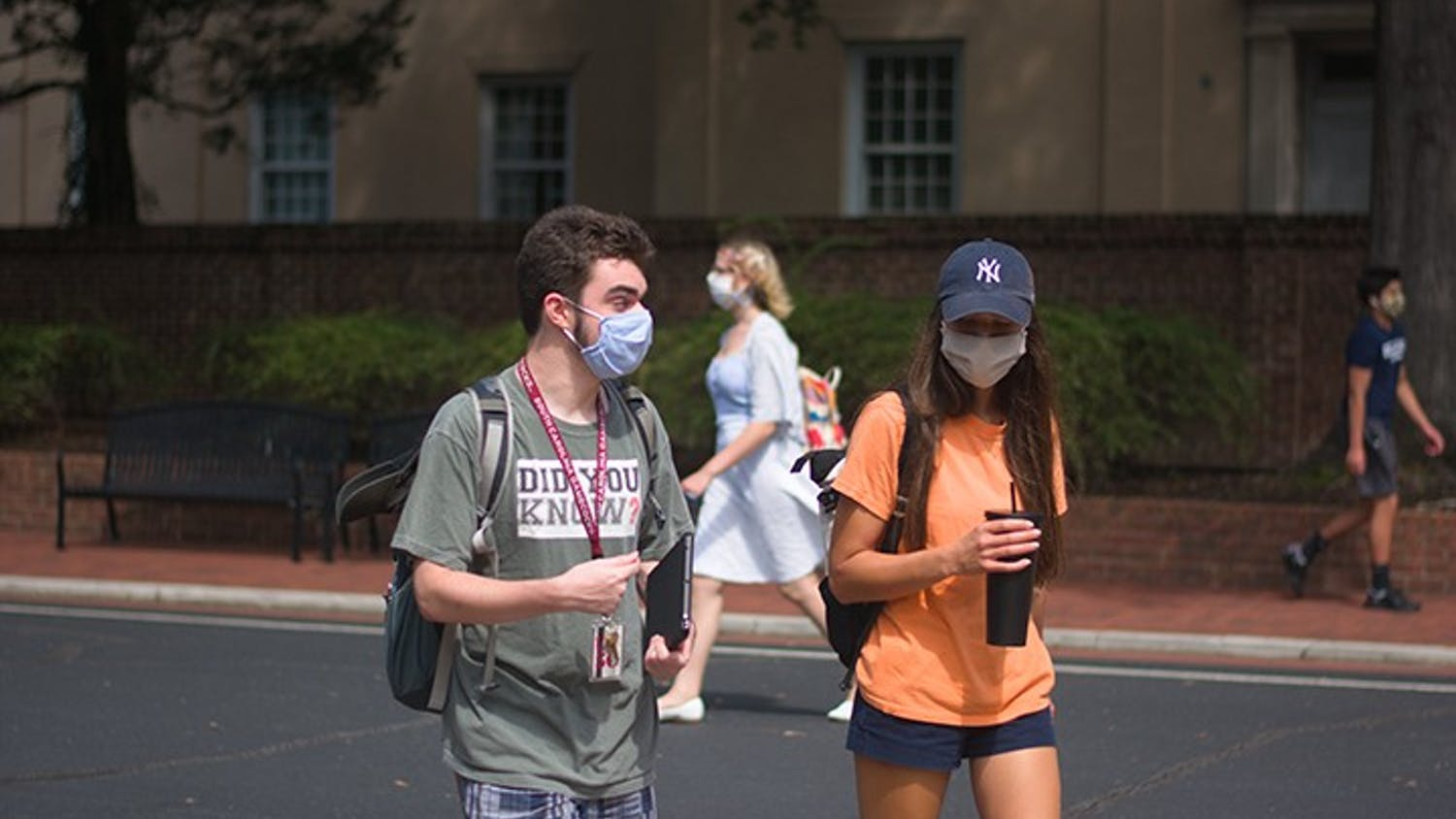 Students walk on campus with masks on. The university has documented over 1,000 student violations related to COVID-19 this semester.