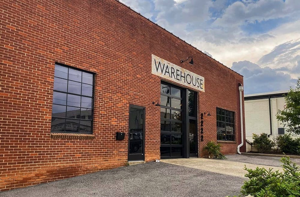 """<p>The storefront of NoMa Warehouse, a place for creatives to gather and work on their projects. The workspace and clothing store was founded by Mazie Cook and Beth Lawson, who gained inspiration from Warhol's """"The Factory.""""&nbsp;</p>"""