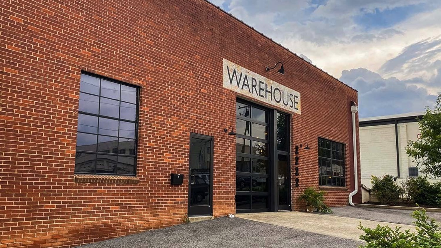 """The storefront of NoMa Warehouse, a place for creatives to gather and work on their projects. The workspace and clothing store was founded by Mazie Cook and Beth Lawson, who gained inspiration from Warhol's """"The Factory."""""""