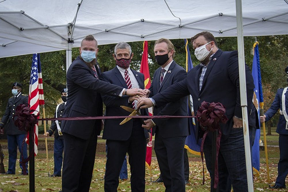 <p>From left to right: Brooks Herring, President Bob Caslen, Jared Evans and Scott Craig cut the ribbon to the new Veteran and Military Center of Excellence at the Horseshoe on Nov. 11, 2020.</p>