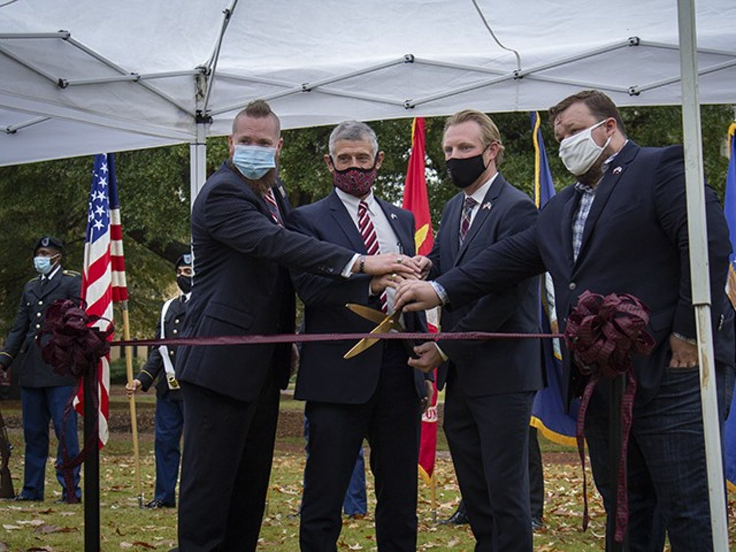 From left to right: Brooks Herring, President Bob Caslen, Jared Evans and Scott Craig cut the ribbon to the new Veteran and Military Center of Excellence at the Horseshoe on Nov. 11, 2020.