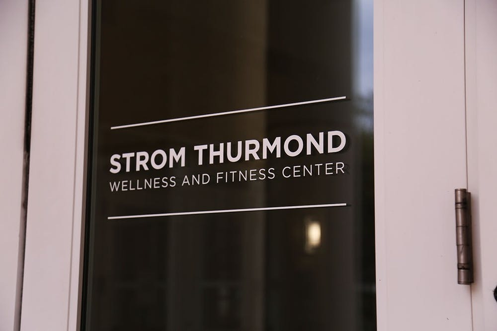 <p>A door marks the entrance to the Strom Thurmond Wellness and Fitness Center.</p>