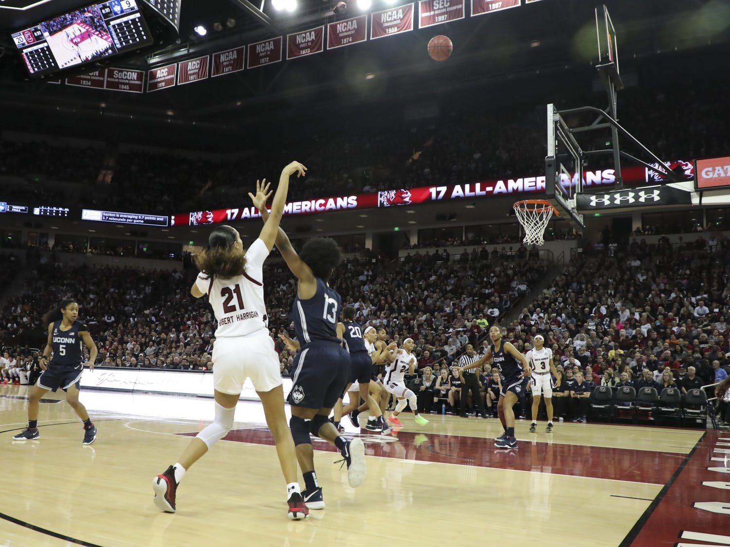 Senior forward Mikiah Herbert Harrigan shoots the ball in a scoring attempt. Harrigan scored 10 points, seven rebounds and two assists against the Huskies.