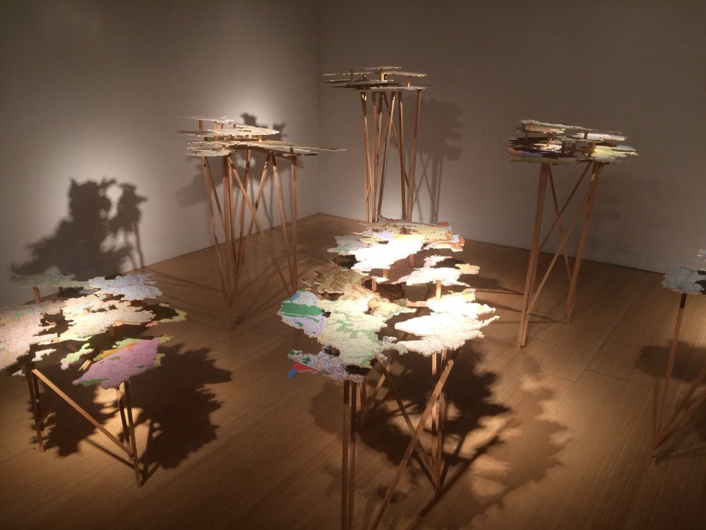 <p>The map and plywood structures of the <em>Fingerreisen</em> exhibit&nbsp;stand erect in the McMaster Gallery.</p>