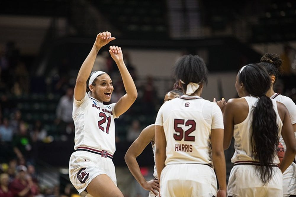 <p>Junior Mikiah Harrigan celebrates with her teammates after South Carolina secured a win against Florida State to advance to the Sweet 16 at the Halton Arena on Sunday.&nbsp;</p>