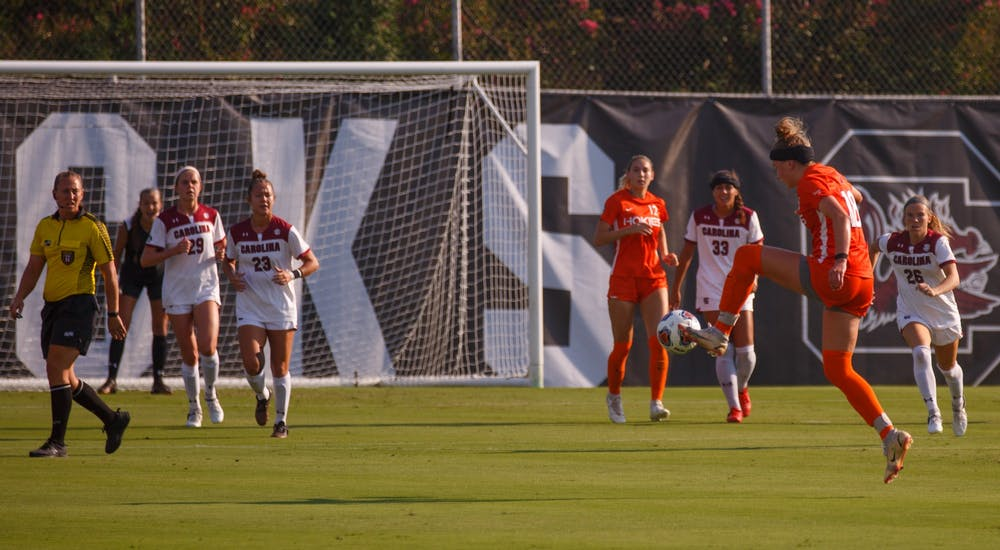 <p>Freshman midfielder Lauren Gogal kicks the ball toward her teammates for Virginia Tech.</p>