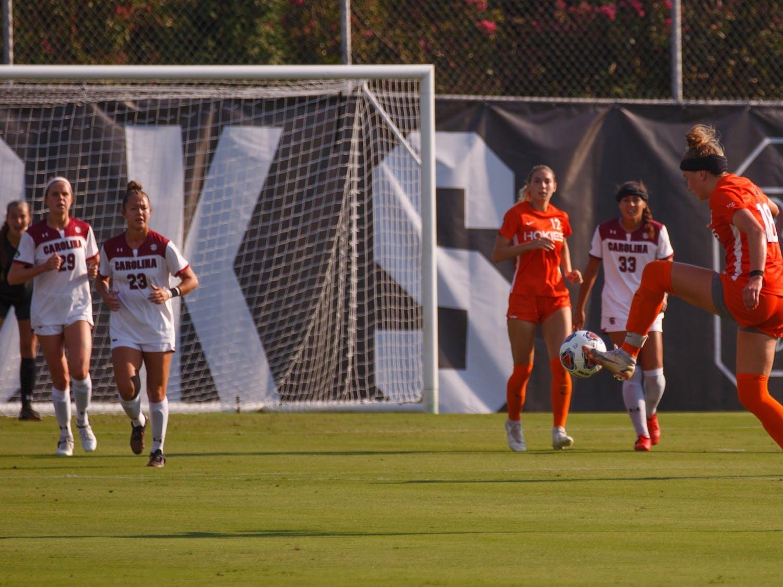 Freshman midfielder Lauren Gogal kicks the ball toward her teammates for Virginia Tech.