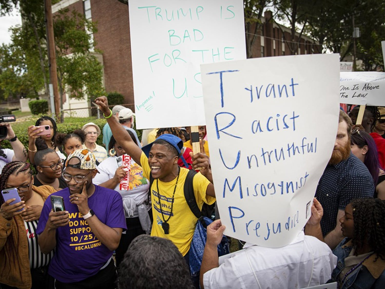 Protesters and President Trump supporters clash outside Benedict College Oct. 25.