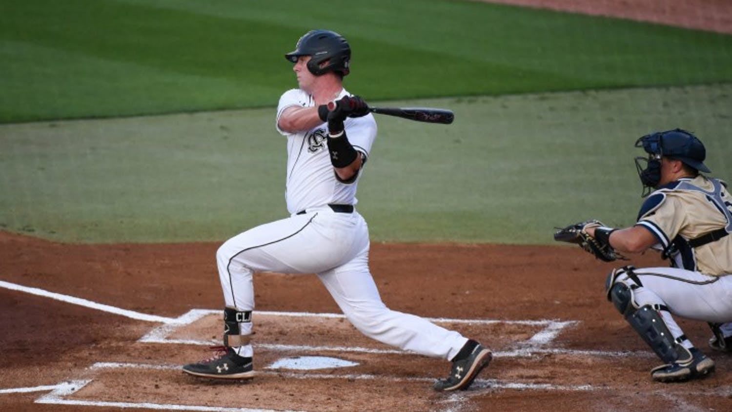 Junior catcher Wes Clarke swings at a pitch during South Carolina's game against Charleston Southern. The Gamecocks won 9-0 on Tuesday.