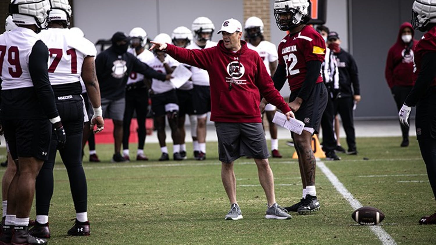Head football coach Shane Beamer works with members of the offensive and defensive lines at the Gamecocks' first spring practice on Saturday, March 20.