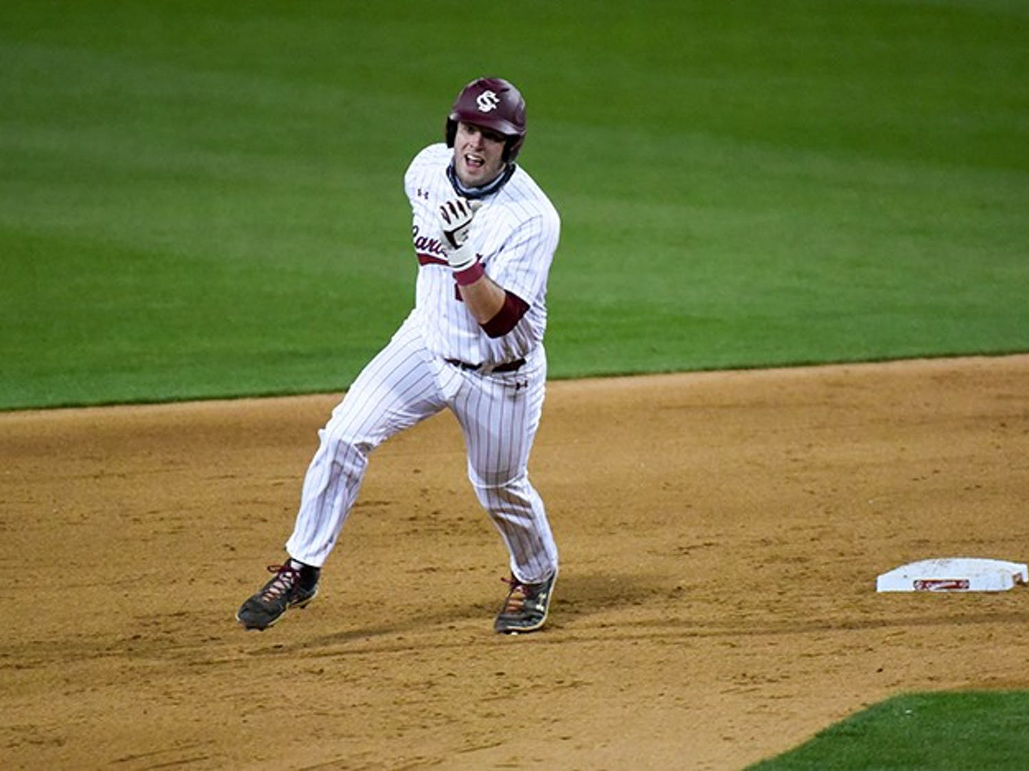 Junior infielder/catcher Wes Clarke rounds the bases during a game. Clarke currently has nine home-runs in 14 games this season.