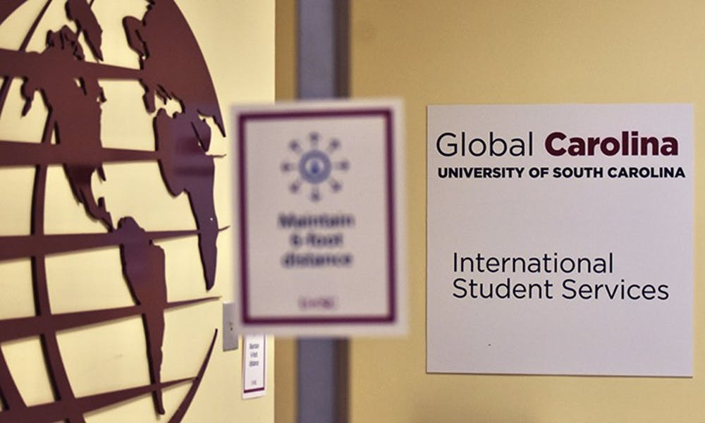 A sign marks the entrance to the International Student Services office in the Close-Hipp building. International student enrollment at USC has seen about a 20% drop this semester.