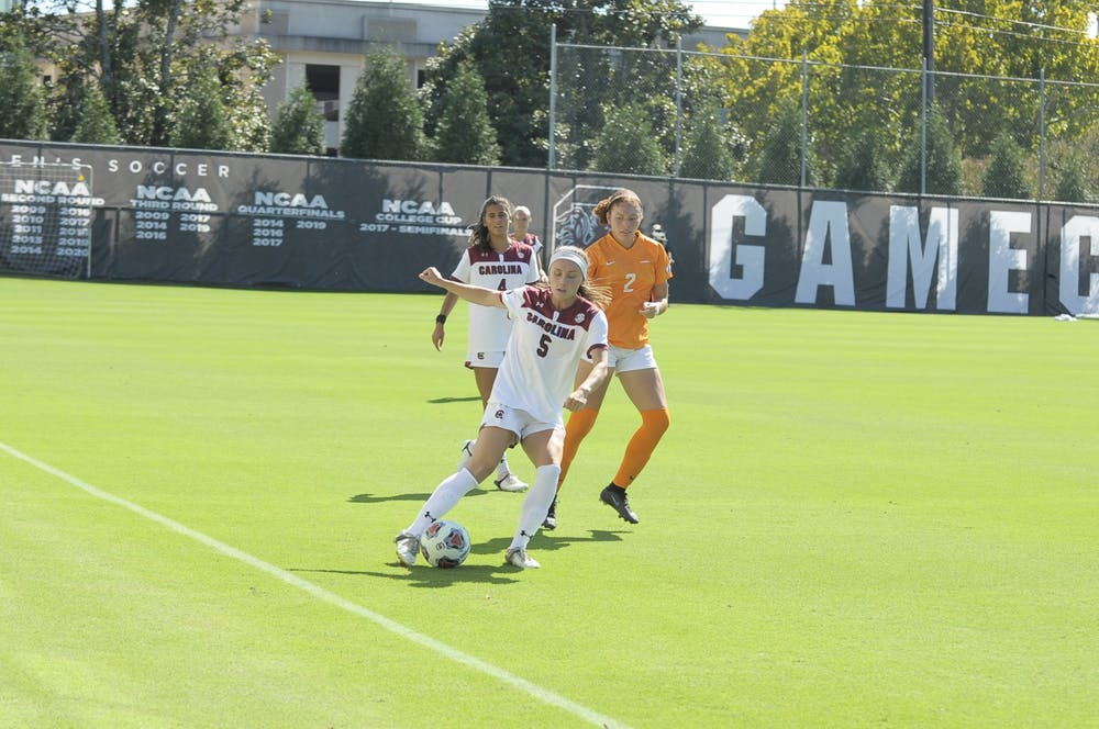<p>Gamecock graduate forward Luciana Zullo keeps the ball in bounds after receiving a pass from a teammate during the game against Tennessee Oct. 10, 2021.</p>