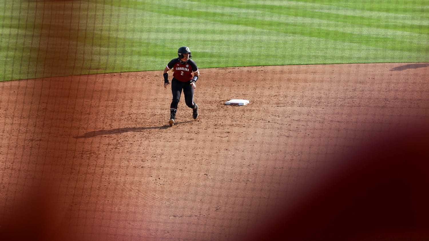 Graduate student infielder Kenzi Maguire stands away from second base in preparation to run to third base.