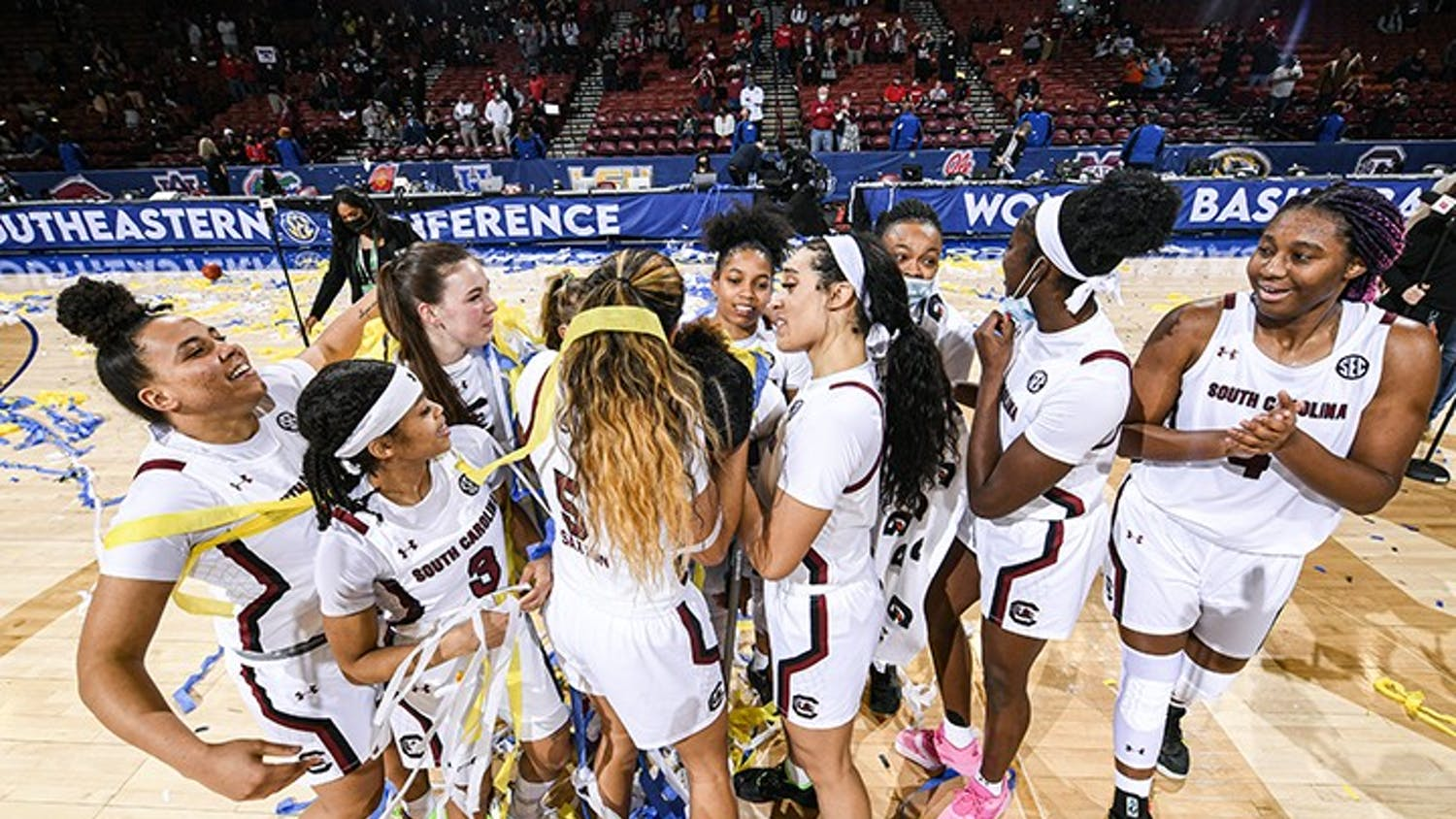 Members of the South Carolina women's basketball team celebrate after defeating Georgia 67-62 in the SEC Championship.