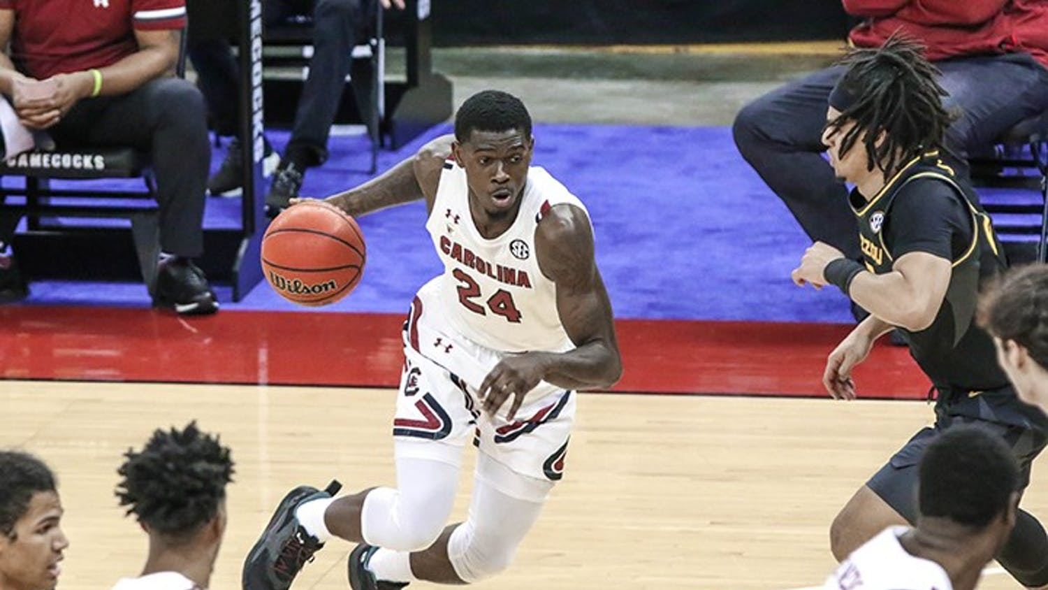 Junior forward Keyshawn Bryant dribbles the ball in the game against Missouri. South Carolina lost, 93-78.