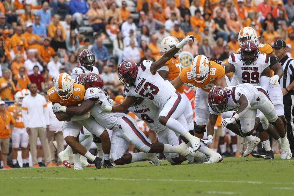 <p>&nbsp;University of South Carolina football player tackles a University of Tennessee player Oct. 26, 2019. South Carolina lost 41-21.&nbsp;</p>