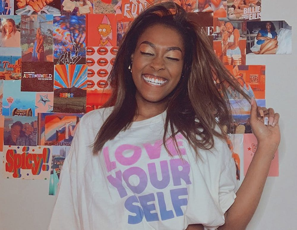 Amber Lipscomb, a campus ambassador, modeling the one size tee from PINK.