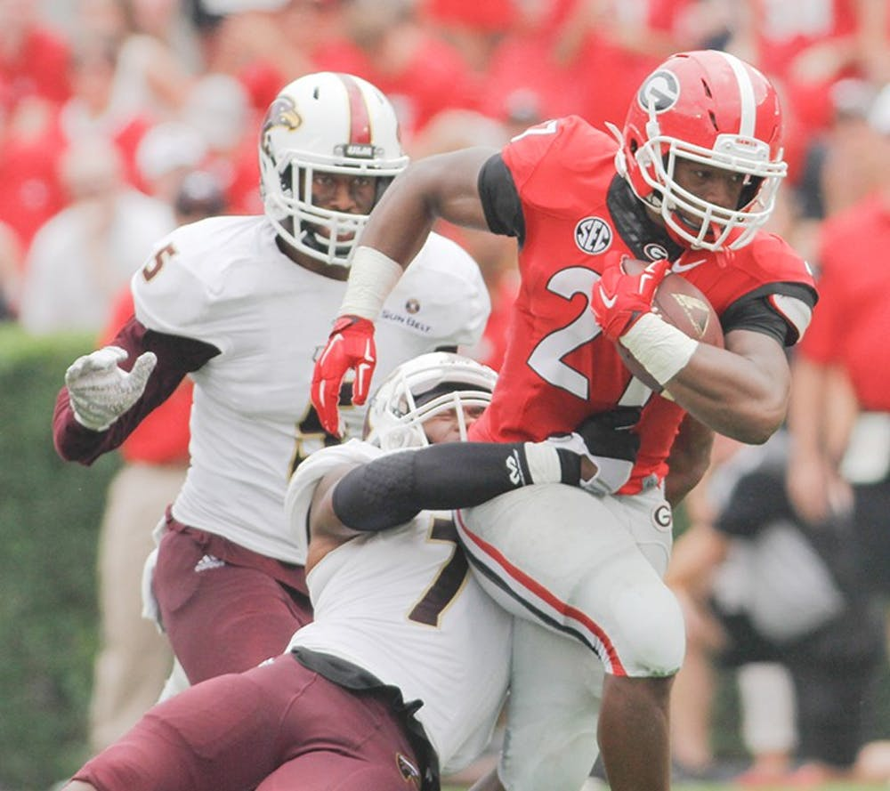Georgia tailback Nick Chubb (27) runs the ball despite Louisiana-Monroe safety Mitch Lane (7) attempts to tackle him in the second half of an NCAA college football game against Louisiana-Monroe, on  Saturday, Sept. 5, 2015, at Sanford Stadium, in Athens, Georgia. (Photo/Taylor Carpenter)