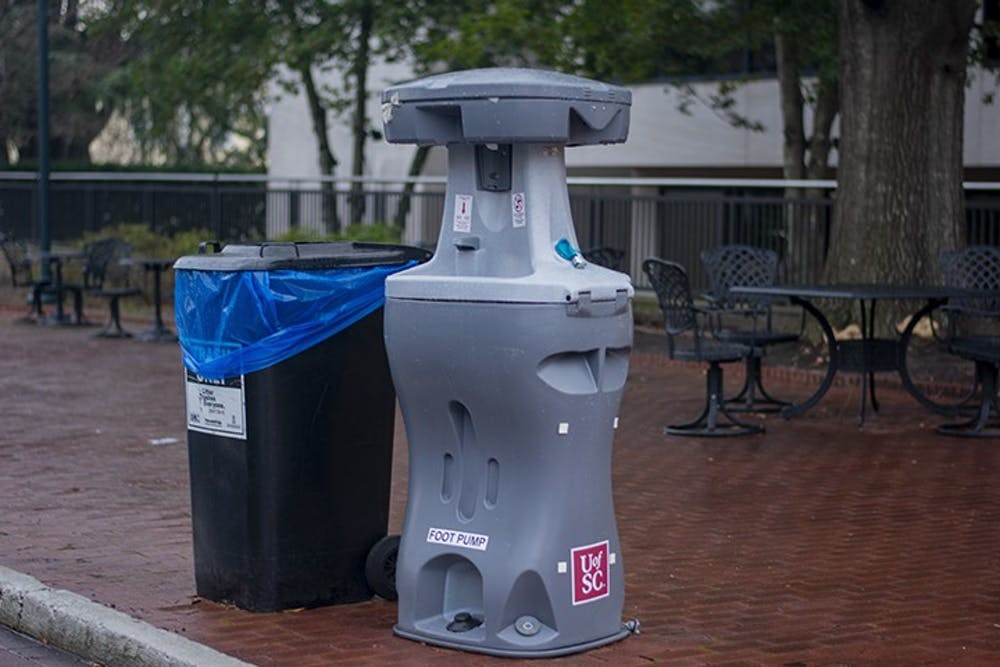 <p>A handwashing station sits on Greene Street outside of Russell House. Handwashing stations are one of the various safety measures implemented by USC as COVID-19 cases continue to rise nationwide.</p>