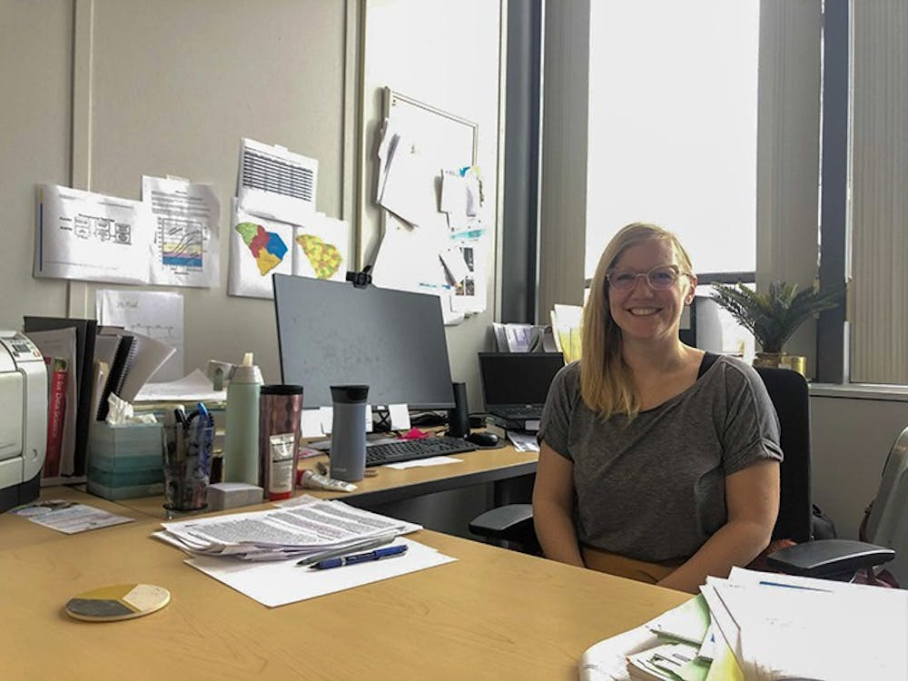 <p>Jessica Bradshaw sits at her desk at the Institute for the Mind and Brain at USC. Bradshaw is the director of the Early Social Development Lab.&nbsp;</p>