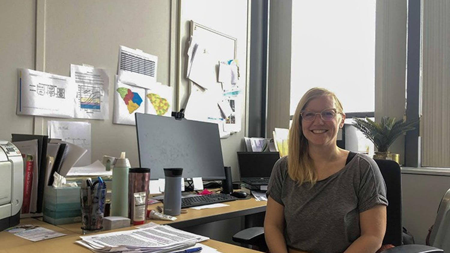 Jessica Bradshaw sits at her desk at the Institute for the Mind and Brain at USC. Bradshaw is the director of the Early Social Development Lab.